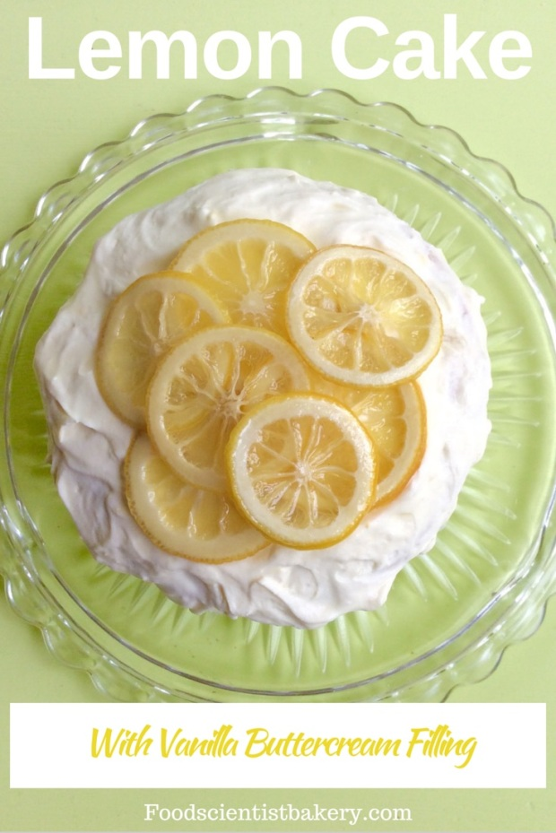 Lemon Cake with Vanilla Bean Filling! Layers of tender cake, filled with vanilla buttercream, frosted with lemon curd cream and topped with candied lemon slices- wow!