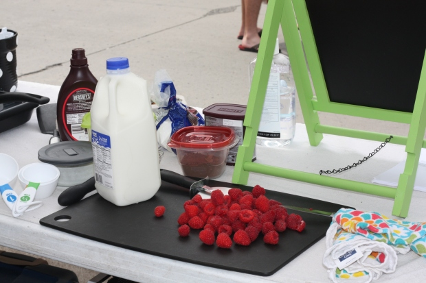 Making chocolate raspberry crepes at the farmers market